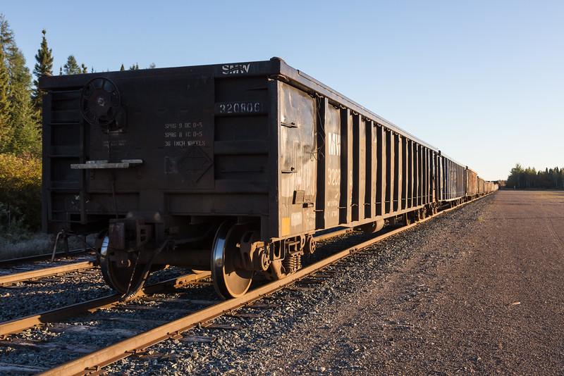 Gondolas cars in Moosonee. Used to bring gravel for Moosonee Airport repaving, held up due to derailment of GP38-2 1804.