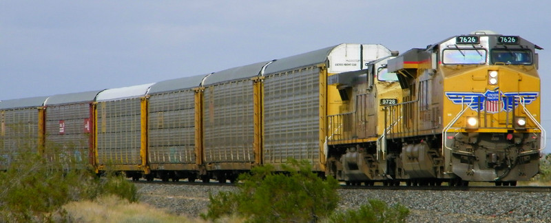 Out in the desert on 11-20-11, taking photos of the occasional passing freight.  Team Whooz has seen 844 at Kelso and is now sitting trackside for it to run by in the open desert on its way to Las Vegas.  Here's a westbound unit train of empty auto rack cars.  The mild desert temperatures of the previous day had taken a dive overnight as a cold front moved in, bringing bitter cold, wind, and clouds with it.