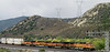 Eastbound BNSF stack train grinds uphill on the low road at Cajon.