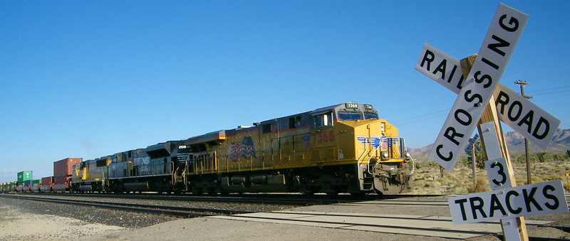 Westbound UP intermodal stack train, with a Norfolk Southern locomotive sandwiched in there.