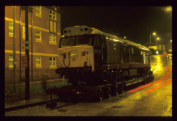08/01/1992....... 50019 sits on its trailer after the unit hauling it failed in Topsham Road on the main road out of the City centre to the M5 in rush hour... The  traffic chaos made the local news! The preserved class 50 was heading to its first home at the Tunbridge Wells & Eridge Railway.