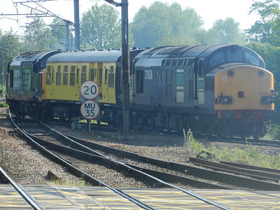 DRS 37038 trails through Ely with a Network Rail inspection coach