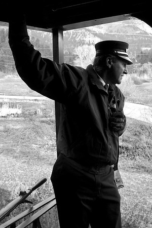 """Brakeman Mike Nichols stands on the open platform of the """"Cinco Animas"""" at Rockwood.  Here, the train will stop to pick up some other passengers who chose to drive up."""