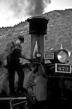 """Fireman Mike May places the white flags on the front of the locomotive, denoting that this trains is an """"Extra"""" or """"Unscheduled"""" train.  The Durango and Silverton still runs on Timetable based schedule. Their regular trains authority is based upon this, and in a way, the same trains that leave Durango daily during the summer, are the same scheduled trains that left Durango over sixty years ago."""