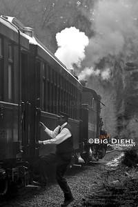 Brakeman George Swift hops aboard the train before departure.