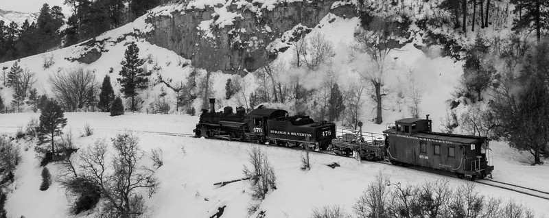 A work train cruising to Durango after a hard days work. It utilized the 19th century flanger to clear the track of recent heavy snowfall farther up the line. 1/17/19