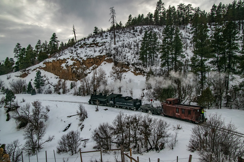 A work train heading home to Durango after a hard days work. It utilized the 19th century flanger to clear the track of recent heavy snowfall farther up the line. 1/17/19