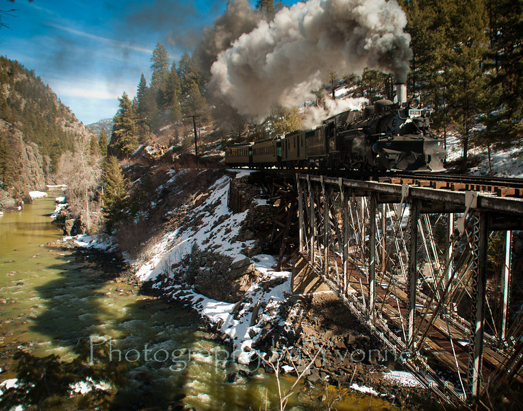 I really liked the shadow of the train and steam in the river below!
