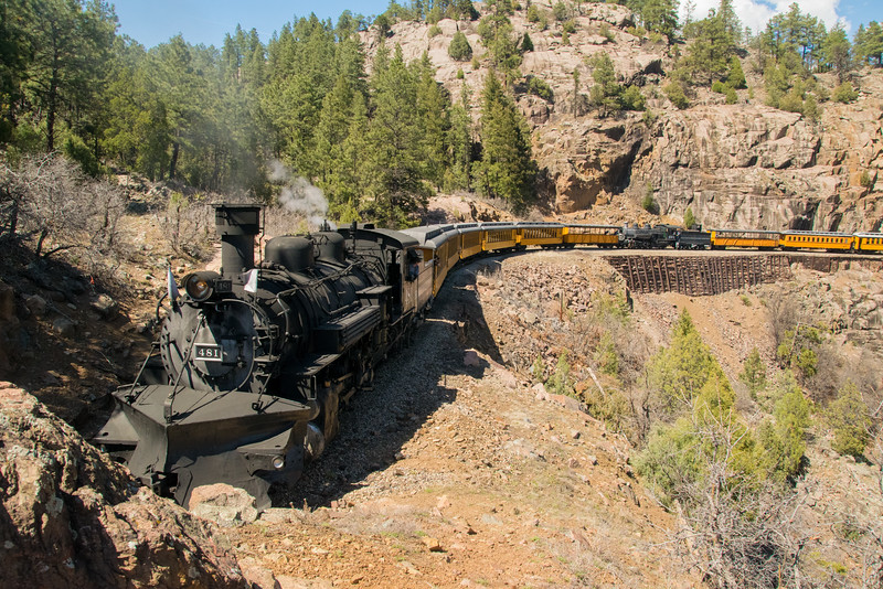 """K37 Locomotive 493 (inoperable) was brought from the Silverton yard to the Durango yard on May 4, 2016. This photo was taken along the famous """"Highline"""" with K36 Locomotive providing the power."""
