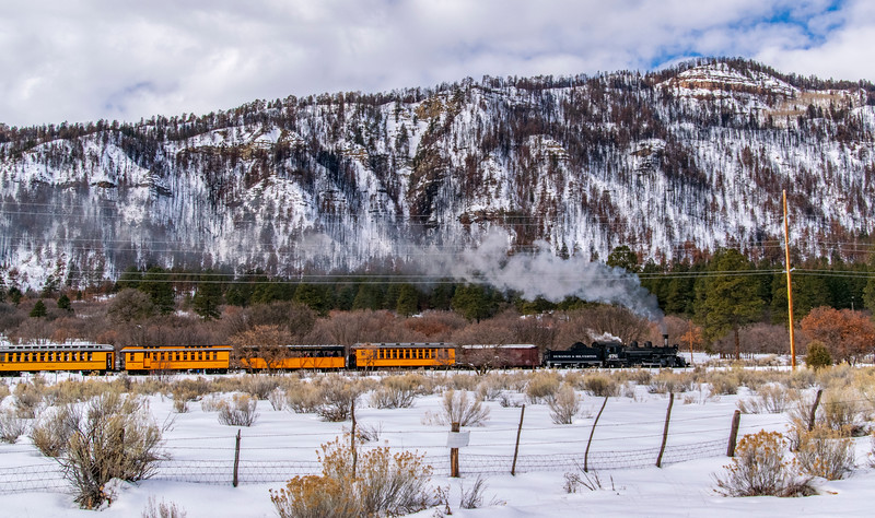 "A Passenger train heads toward its Cascade Canyon destination. Note the burn scar on the hills from the 2018 ""416 Fire""."