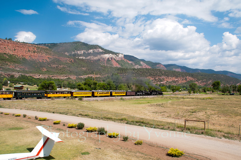 Pulling a 15-car consist, the K-28 double header train heads up the Animas Valley past the Glider Park. 6/26/12