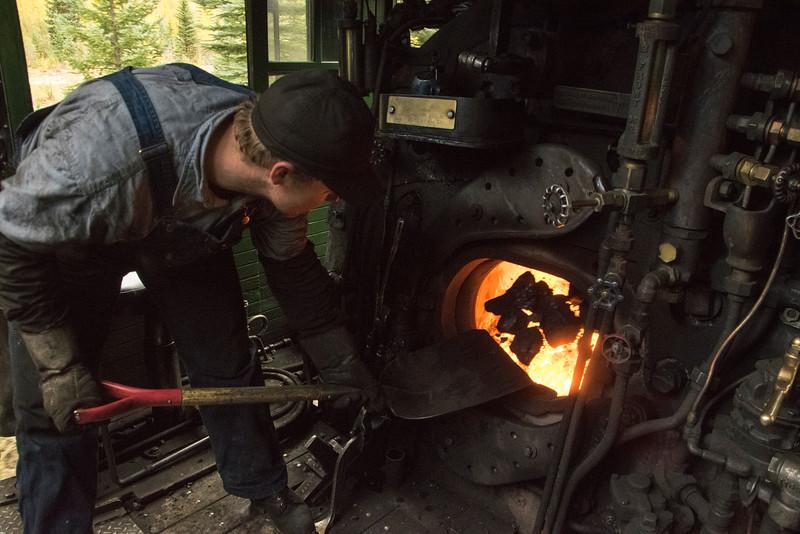 View inside the cab of the locomotive, Fireman Matt shovels the coal