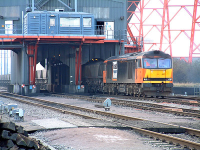 60007 in Loadhaul livery runs under the loader at Avonmouth Bulk Handling Terminal loading an MGR bound for Didcot Power Station. 3rd Jaunuary 2002.