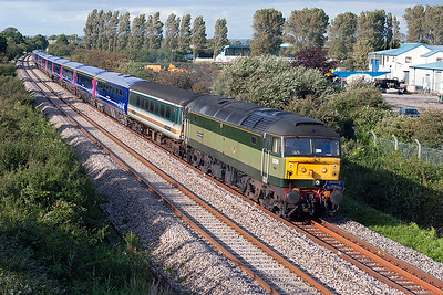47815 'Great Western' with a Bristol Bluebirds headboard passes Oldmixon on the Wston-super-Mare avoiding line 5Z90 Derby to Laira Depot consisting of refurbished HST coaches. 10th July 2007.