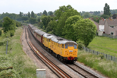 31105 & 31285 head the 'Bristol Stone Coal Haul' Railtour past Henbury heading for Avonmouth, 50049 is on the rear. The 31 carries a Three Peaks Challenge headboard. 3rd June 2007.