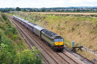 47815 'Great Western' passes Flax Bourton with 5Z90 Laira Depot to Derby with HST coaches for refurbishment. Consisting of 44033, 42272, 42271, 41132, 41131 & 42273 with barrier vehicles 6338 & 6330. 17th September 2007.
