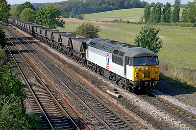 56070 passes Melton Ross with an empty MGR from Scunthorpe to Immingham. 17th September 2003.