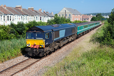 With the booked Class 57 having failed, Ex DRS 66402 (now 66734) heads away from Weston-super-Mare with the empty stock of the 09.13 Bristol Parkway to Weston, prior to working a Taunton to Cardiff service. 57308 is DOR. 28th June 2010.