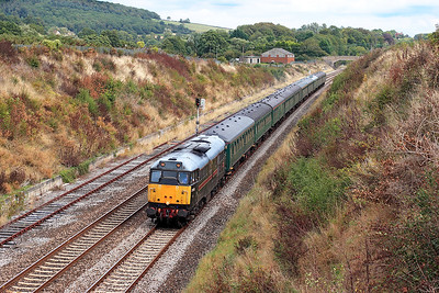 31128 'Charybdis' passes Flax Bourton with 5Z82 Westbury to Bishops Lydeard with stock from a Cathedrals Express for servicing. 31st August 2006.
