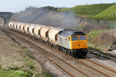 Cotswold Rail's 47813 'John Peel' passes the fuel dump at Flax Bourton with 6F68 St. Blazey & Tavistock Junction Yard to Gloucester New Yard conveying China Clay tanks going off lease. 7th March 2007.