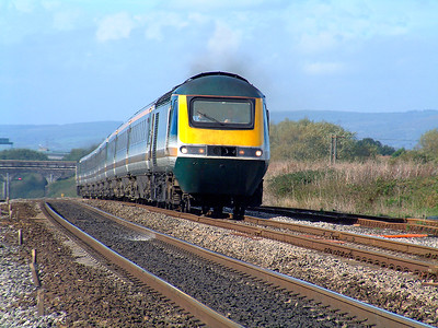 A First Great Western HST in original livery powers up Pilning bank climbing out of the Severn Tunnel forming a Swansea to Paddington service. 18th October 2001.