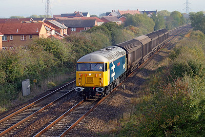 Shortly after repainting 56078 'Doncaster Enterprise' passes Locking Castle on the Weston-super-Mare avoiding line with 6C91 Newport ADJ Yard to Bridgwater trip working. 21st October 2003.