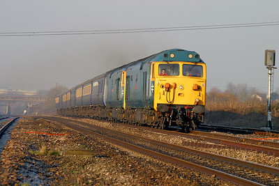 50049 'Defiance' & 50031 'Hood' power up Pilning bank with a Cardiff Canton to Bristol Temple Meads empty stock move prior to working a Pathfinder Tour's Christmas dinning special. 18th December 2003.