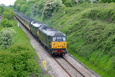 31452 'Minotaur' & 31602 'Chimaera' head along the split level section approaching Patchway tunnel with 1Z30 09.35 Southampton to Cardiff Central Footex, in connection with the 2003 Cup Final Arsenal v Southamton. 17th May 2003.