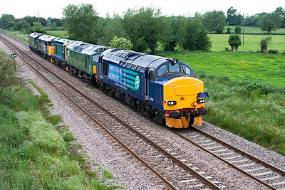 37423 with 'DRS Crewe on a Mission' headboard passes Claverham east of Yatton with 0Z51 Totnes to Crewe Gresty Lane consisting of D7612, 20110, 31108 & D6737 (37037). The loco's were heading to the Keithley & Worth Valley Railway Diesel Gala. 3rd June 2008.