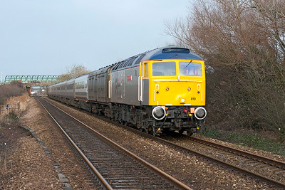 Cotswold Rail's 47810 'Captain Sensible' passes Worle Parkway with 5Z77 12.00 Derby to Laira Depot Ex Midland Mainline HST coaches for re-furbishment and use by FGW, consisting of 44027, 42225, 42227, 42229, 42194, 40749, 41067 & 41112 with barrier vehicles 6338 & 6330. 27th February 2007.