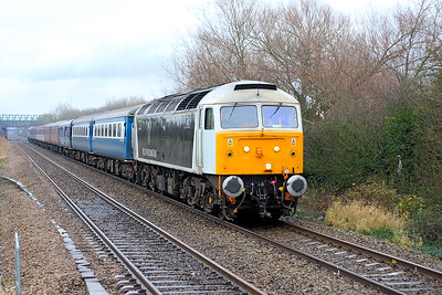 47832 in the short lived Victa Westlink Rail livery is top & tailed with 47802 passing Worle Parkway with 5Z69 Bristol Temple Meads to Bishops Lydeard. They had worked a 1Z69 Redhill to Bristol Temple Meads excursion and were taking the stock for servicing. 4th December 2007.