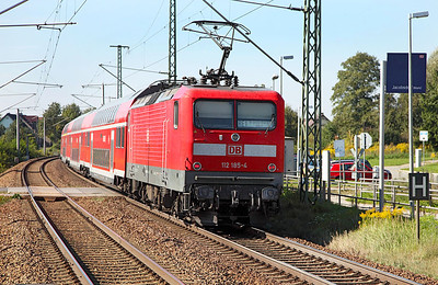 112 185 speeds over Jacobsdorf (Mark) level crossing on an RE1 service from Frankfurt (Oder) to Brandenburg. 23rd September 2010.