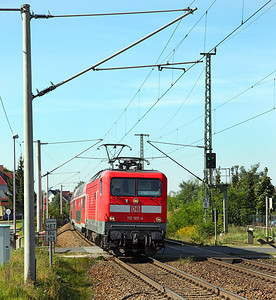 112 185 passes over Jacobsdorf (Mark) level crossing and runs non-stop through the station on a service to Frankfurt (Oder). 23rd September 2010.
