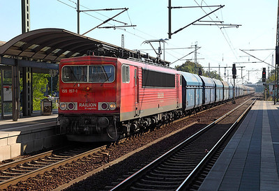 155 157 heads loaded PKP coal hoppers westbound at Furstenwalde (Spree). 23rd September 2010.