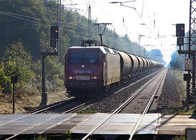 Arcelor 145-CL 001 heads out of the low morning sun with a westbound tank train at Hangelsberg. 23rd September 2010.
