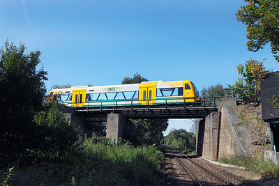 A Stadler RegioShuttle RS1 VT 650-06 of Ostdeutschen  Eisenbahngesellscaft (ODEG) arrives at Werbig on the high level working a Frankfurt (Oder) to Berlin Lichtenberg service. 22nd September 2010.