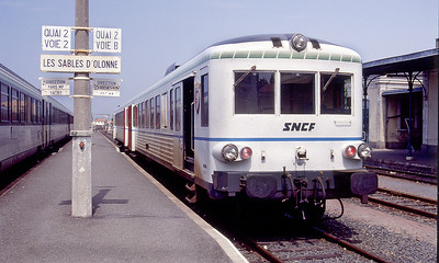 2 Car Class 4630 DMU with hydraulic transmission X 4673 waits at Les Sables D'Olonne with the 13.44 departure to La Rochelle. August 1989.