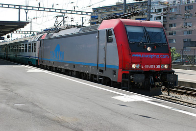 E484.018 SR departs Geneva for Milan. 30th May 2007.