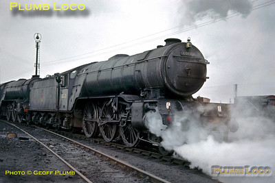 After standing for a while, LNER V2 class 2-6-2 No. 60810 has its cylinder cocks open as it shunts an unidentified classmate (double-chimneyed) around in the yard at Doncaster MPD on a miserable Sunday 16th February 1964. Slide No. 518.