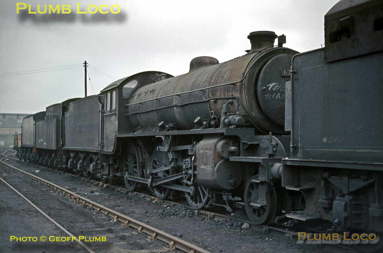 An unidentified typically filthy LNER K1 class 2-6-0 sits on a storage road at Doncaster, looking as though it is unlikely that it will move under its own steam again. Sunday 16th February 1964. Slide No. 516.