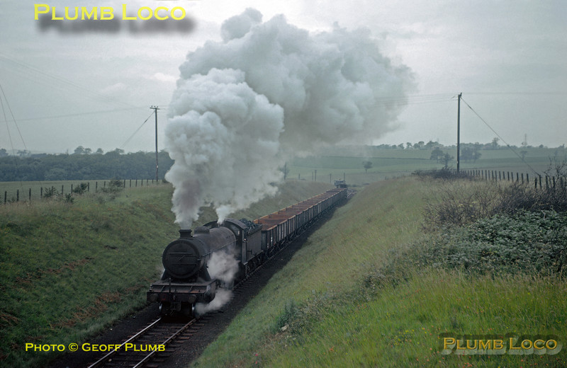 From the Geoff Plumb Collection of original slides. LNER O2/2 three cylinder 2-8-0 No. 63941 sets off away from the East Coast Main Line at High Dyke sidings with an empty train of iron ore wagons to return to the quarries at Colsterworth on Sunday 7th July 1963. Photographer unknown. Collect Slide No. 28664.