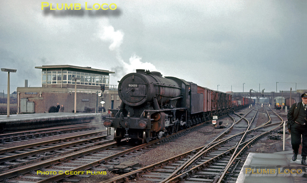 WD 2-8-0 No. 90480 trundles south through Doncaster station on the up fast line with a mixed freight train on the afternoon of Monday 17th February 1964. Slide No. 522.