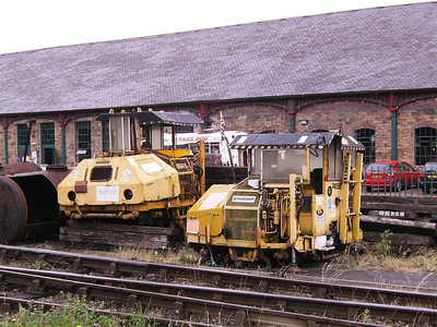 A pair of Permaquip ballast packers, 74058 and 74059, photographed from the Platform