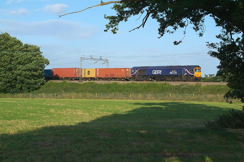 Apart from some arboreal framing , 3 days later , it's the same picture, same train in the same spot , with the same loco,<br /> Lightning does strike twice on occasions.<br /> 66725   8.7.2016<br /> This evening shot has just 6 weeks more to go this year  before the shadows get too long and it will be April 2017 before it's on again.