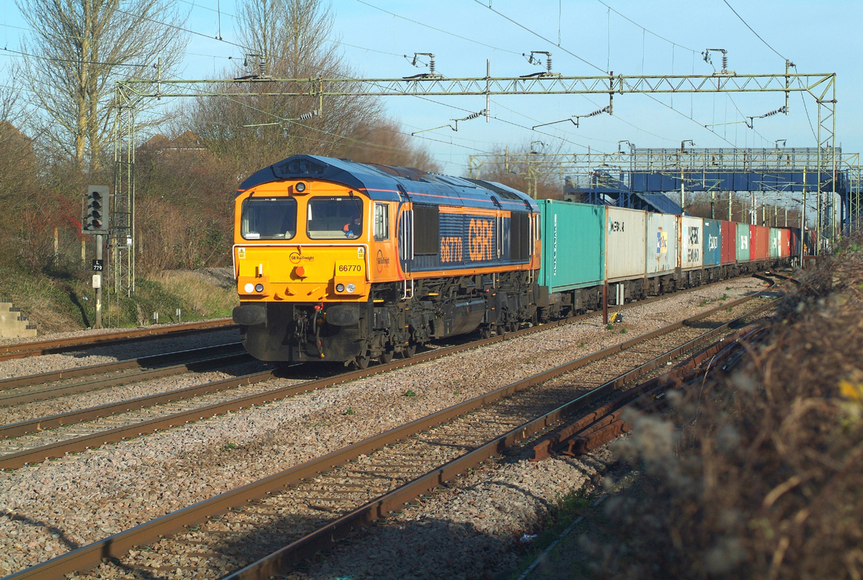 Running 45 late but still not looped , Saturday being the only day it runs through Witham on Platform 2. 66770 16.1.2016 12.35hrs. 4M23 10.34 Felixstowe N GBRf-Hams Hall GBRf.