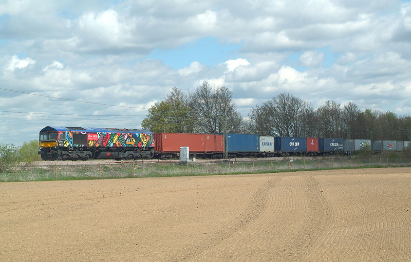 Loco in sun , train still in the dull.  Lucky ? Possibly ?  Now GBRf ,you can get it repainted any time you like .<br /> 66718 Terling Rd. 28.4.2016 12.25hrs. 4M23 10.46 Felixstowe N GBRf-Hams Hall GBRf.