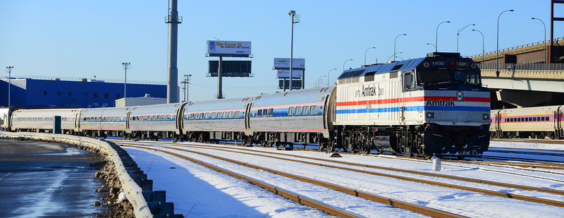 The Downeaster with Amtrak 406 heads back from the wash rack at Boston Engine Terminal.