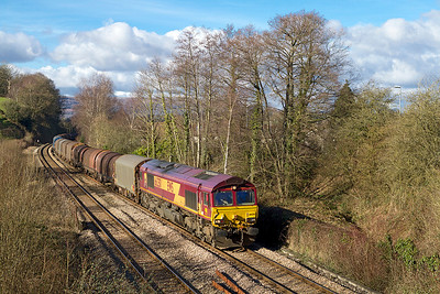 66250 passes Ponthir with 6V75 09.30 Dee Marsh to Margam via Llanwern empty steel carriers. Saturday 2nd February 2013.