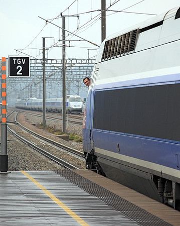 The driver of TGV 288 from Nice to Paris Gare de Lyon looks back to see what is holding up his departure as another pair of TGV's arrive at Avignon TGV Station. 04/06/2011