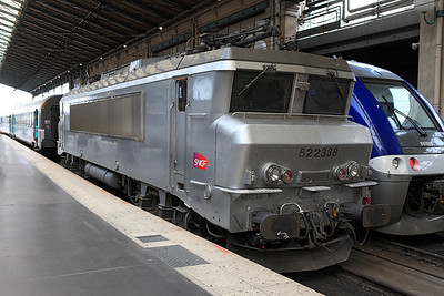 All silver Electric loco 522338 stands on the blocks at Gare du Nord having recently brought a train in. 04/06/2011